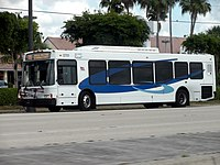"""A Broward County Transit bus in the current """"Breeze"""" livery."""