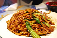 Shanghai fried noodles. Oily, saucy flavors, enhanced by MSG and starches.