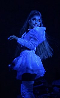 Grande performing on her Sweetener World Tour in 2019