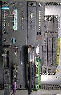 Siemens Simatic S7-400 system in a rack, left-to-right: power supply unit (PSU), CPU, interface module (IM) and communication processor (CP).