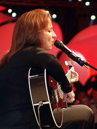 Estefan performs at an event to celebrate the United Through Reading program aboard the Nimitz class aircraft carrier USS Theodore Roosevelt (CVN-71), September 14, 2006