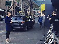 Seven News Sydney and Sunrise reporter Jessica Ridley reporting outside the Australian Broadcasting Corporation's Ultimo studios in Sydney.