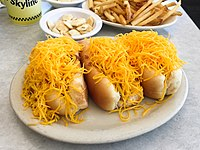 Cheese coneys containing Cincinnati chili, developed in the 1920s by Macedonian immigrants in Cincinnati.