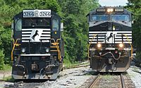 A former Southern Railway SD40-2 with a new Admiral Cab (on the left), being passed by another NS train.
