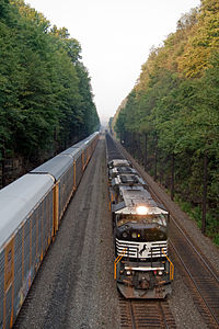 Two NS trains heading east along the Pittsburgh Line
