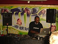 DJ Jazzy Jeff, who is also a record producer, manipulating a record turntable in England in 2005.