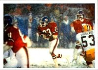 John Elway (right) hands the ball for a rushing play against the Packers in 1984.