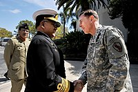 CNS Adm Noman Bashir shakes hand with General David Petraeus to strengthen the partnership with the United States.