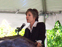 Boxer speaking at an event.