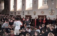 Pupils fight for the pancake (left), watched by the dean of Westminster Abbey and the head master (right). The set of scales determines the winner.