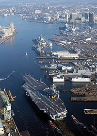 View of the Elizabeth River with Downtown Norfolk at top right. The carrier in the foreground is.
