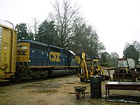 """CSX SD40-2 8449, seen in Senatobia, Mississippi, on former IC rails pulling an auto train with the """"dark future"""" paint scheme"""