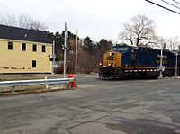 GEVO leads a Pan Am Railways mixed freight train in Andover, Massachusetts