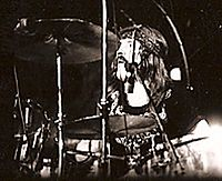 John Bonham, on stage in the US in 1973, whose aggressive drumming style was critical to the hard rock sound associated with the band
