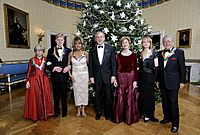 U.S. President George W. Bush and First Lady Laura Bush pose with the Kennedy Center honorees, from left to right, actress Julie Harris, actor Robert Redford, singer Tina Turner, ballet dancer Suzanne Farrell and singer Tony Bennett on December 4, 2005, during the reception in the Blue Room at the White House.