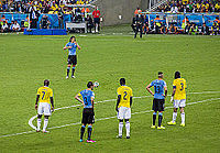 Cavani waiting to take a free-kick in the Round of 16 game against Colombia at the 2014 World Cup