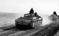 German panzers of the Afrika Korps advancing across the North African desert, 1941