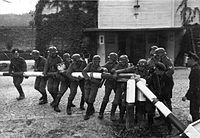 Soldiers of the German Wehrmacht tearing down the border crossing into Poland, 1 September 1939