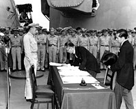 Japanese foreign affairs minister Mamoru Shigemitsu signs the Japanese Instrument of Surrender on board, 2 September 1945