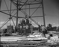 """Nuclear Gadget being raised to the top of the detonation """"shot tower"""", at Alamogordo Bombing Range; Trinity nuclear test, New Mexico, July 1945"""