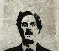 Graffiti of Cleese as Basil Fawlty in Lisbon, Portugal.