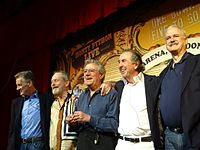 Cleese (right) with the rest of Monty Python on stage at the O2 Arena, London, in July 2014