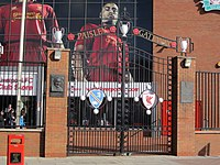 The Paisley Gateway is a tribute to former manager Bob Paisley, who won a record three European Cups—and three European trophies in successive seasons—as Liverpool manager.
