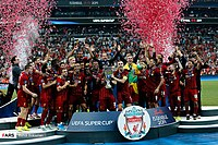 Liverpool winger Sadio Mané lifting the 2019 UEFA Super Cup after scoring twice against Chelsea in the final.