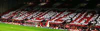 """Fans in the Kop hold a mosaic during the match with Juventus, 6 April 2005. Amicizia means """"friendship"""" in Italian."""