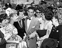 Sinatra in a 1943 publicity photo surrounded by a group of lady fans