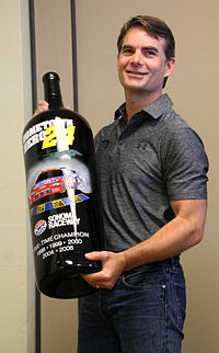 Gordon with a commemorative wine bottle celebrating his wins at Sonoma Raceway
