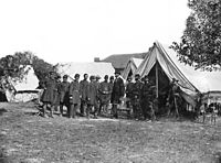 Lincoln with McClellan and staff after the Battle of Antietam. Notable figures (from left) are 5. Alexander S. Webb, Chief of Staff, V Corps; 6. McClellan;. 8. Dr. Jonathan Letterman; 10. Lincoln; 11. Henry J. Hunt; 12. Fitz John Porter; 15. Andrew A. Humphreys; 16. Capt. George Armstrong Custer