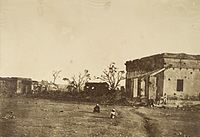 """Photograph entitled, """"The Hospital in General Wheeler's entrenchment, Cawnpore"""". (1858) The hospital was the site of the first major loss of British lives in Cawnpore"""