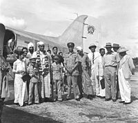 Passengers and bystanders with an Orient Airways Douglas DC-3 on the occasion of the arrival of the Burmese High Commissioner to India at Calcutta, circa 1947