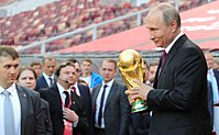 President Vladimir Putin holding the FIFA World Cup Trophy at a pre-tournament ceremony in Moscow on 9 September 2017
