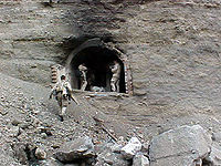 Navy SEALs at one of the entrances to the Zhawar Kili cave complex