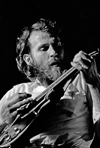 Helm playing mandolin in 1971