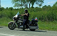 A uniformed OPP officer on motorcycle, 2015
