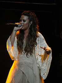 Demi Lovato rose to prominence in 2008 when she starred in the Disney Channel television film Camp Rock and signed a recording contract with Hollywood Records.