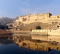 Amber Fort has seen from the bank of Maotha Lake, Jaigarh Fort on the hills in the background