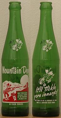 """Two sides of an early Mountain Dew bottle using the """"Hillbilly"""" design. These returnable bottles could be found in stores and vending machines until the late 1980s."""