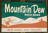 """A 1950s Mountain Dew advertisement sign in Tonto, Arizona, showing the cartoon character """"Willie the Hillbilly"""""""