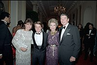 (Left to right) Nancy McKeon, Michael J. Fox, Nancy Reagan, and then-United States President Ronald Reagan in October 1985. Back to the Future has been interpreted as an endorsement of Reagan-era policies concerning the American dream, self-reliance, initiative, and technological advancement.