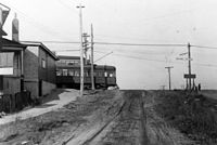 A streetcar on Kingston Road, looking south on Birchmount Road. The first transit line in Scarborough was established in 1893.