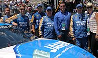 Driver Sam Hornish, Jr. (second from left) and the No. 9 team at Sonoma in 2015.