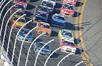 Jimmie Johnson leads the field racing three-wide multiple rows back with 32 laps remaining.