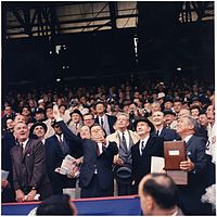 Opening Day of 1961 baseball season. President Kennedy throws out the first ball at Griffith Stadium, the home field of the Washington Senators, as LBJ and Hubert Humphrey look on.