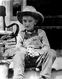 Seven-year-old Johnson with his trademark cowboy hat, c.1915.
