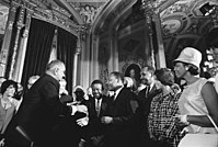 President Lyndon B. Johnson, Martin Luther King Jr., and Rosa Parks at the signing of the Voting Rights Act on August 6, 1965