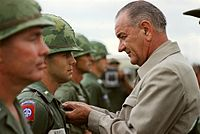 Awarding a medal to a U.S. soldier during a visit to Vietnam in 1966